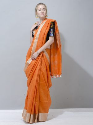 Bright orange linen saree with silver border