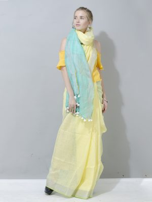 Spectacular yellow and sea green contrast linen saree