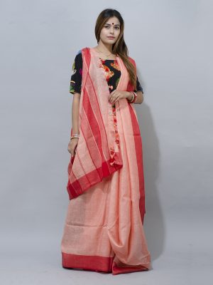 traditional pink and red par saree synonymous with the women of Bengal