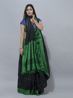 a lovely black and green combination linen saree