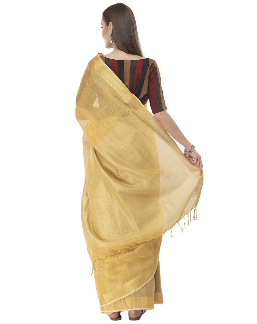MESMERIZING DEEP GOLDEN TISSUE LINEN SAREE WITH PLAIN PALLU AND RUNNING BLOUSE