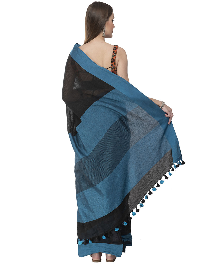 classy, bold and eye-catching! black linen saree with blue border looks very sophisticated, artistic